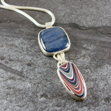 Fordite and Kyanite pendant in sterling silver