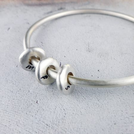 Pebble bangle in frosted sterling silver
