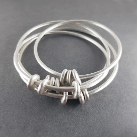 Silver pebble bangle in brushed silver