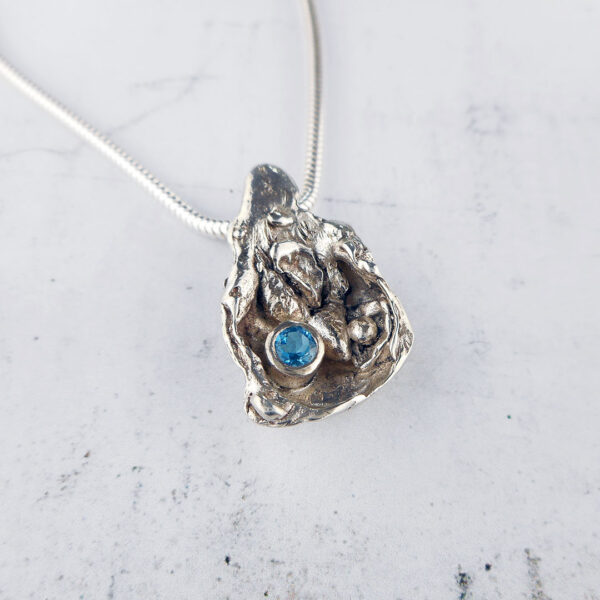Gem cave pendant in sterling silver with Swiss blue topaz