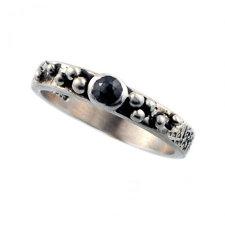 Black diamond and graffiti silver ring
