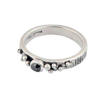 Black diamond and graffiti silver ring