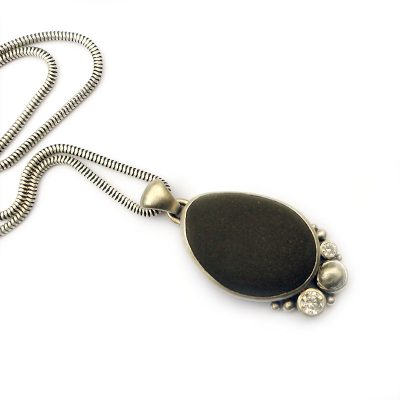 beach pebble, tin and cubic zirconia pendant in silver