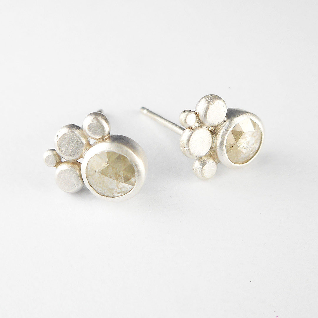 white rose cut diamond stud earrings in silver