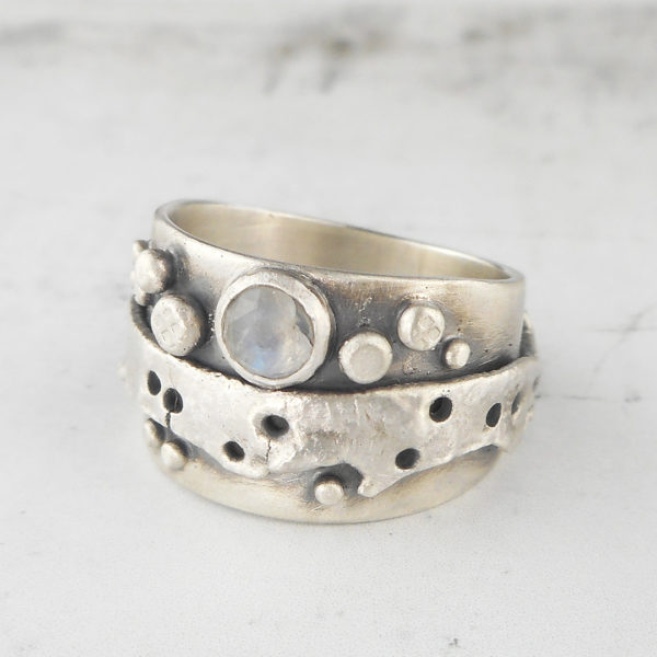 One of a kind Relik ring with rainbow moonstone, textures and patina