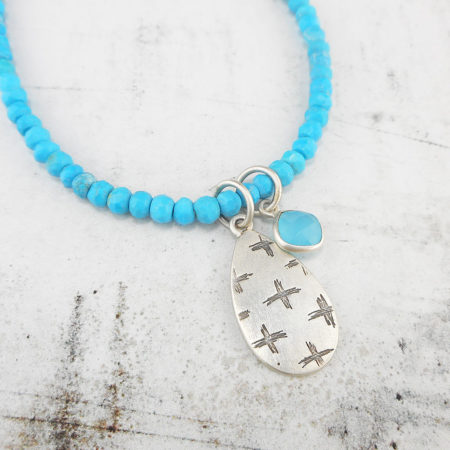 Turquoise necklace with etched pendant