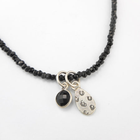 Black spinel necklace with etched pendant