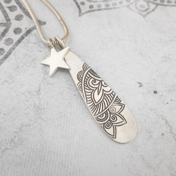 Slender silver Mehndi pendant with star charm