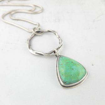 green turquoise and heat textured silver pendant