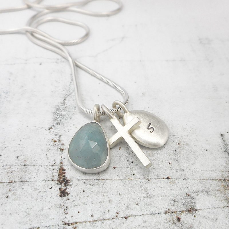 cluster pendant with aquamarine, silver pebble and cross