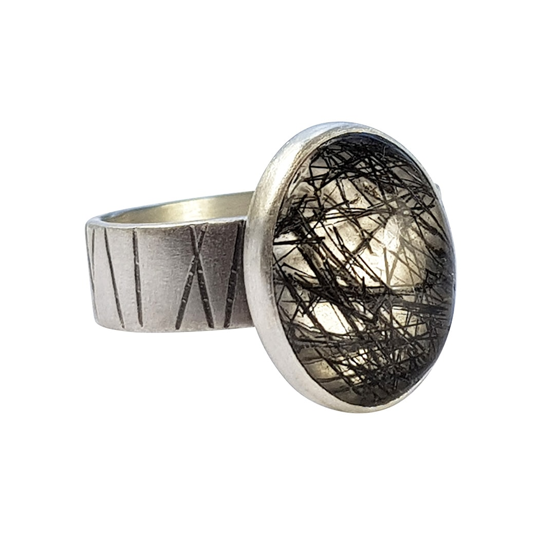 Black tourmalated quartz on stripey band
