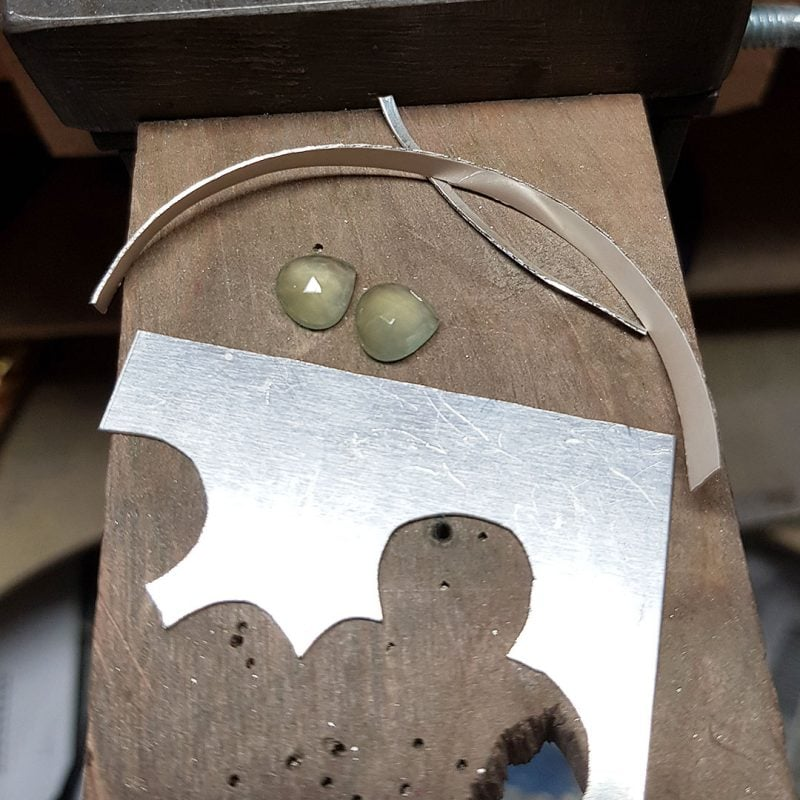 The making of a pair of prehnite and silver leaf earrings 1