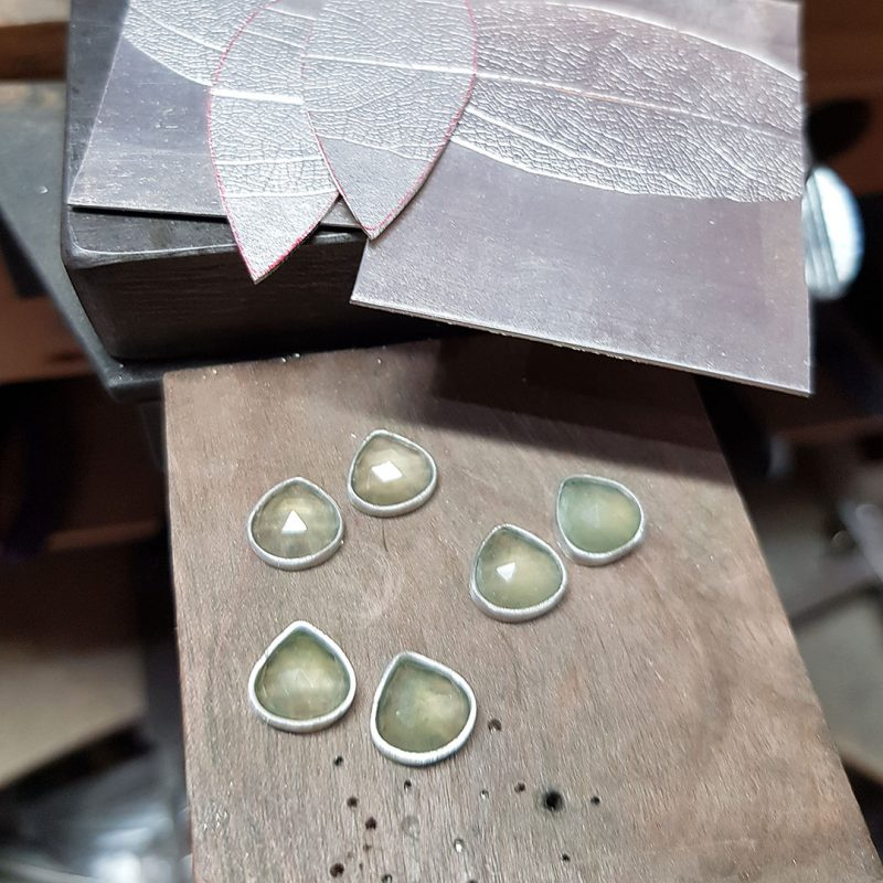 The making of a pair of prehnite and silver leaf earrings 3