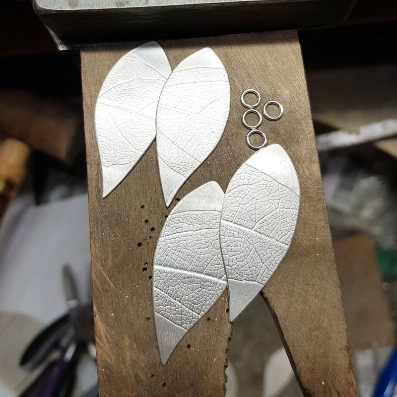 The making of a pair of prehnite and silver leaf earrings 6