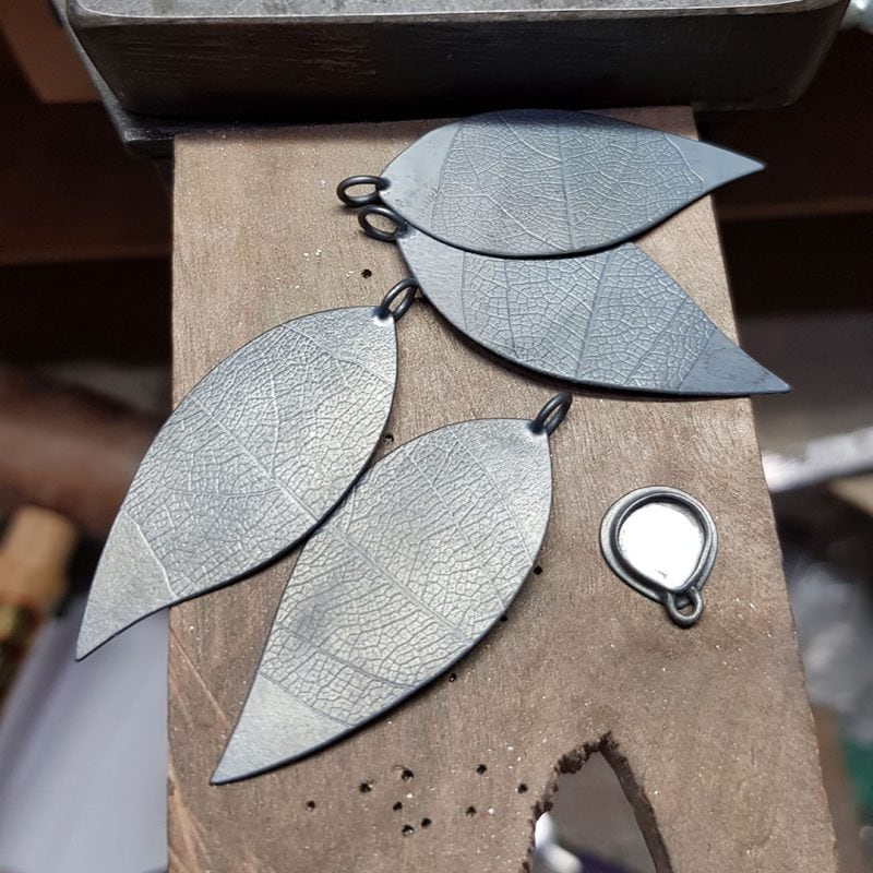 The making of a pair of prehnite and silver leaf earrings 7