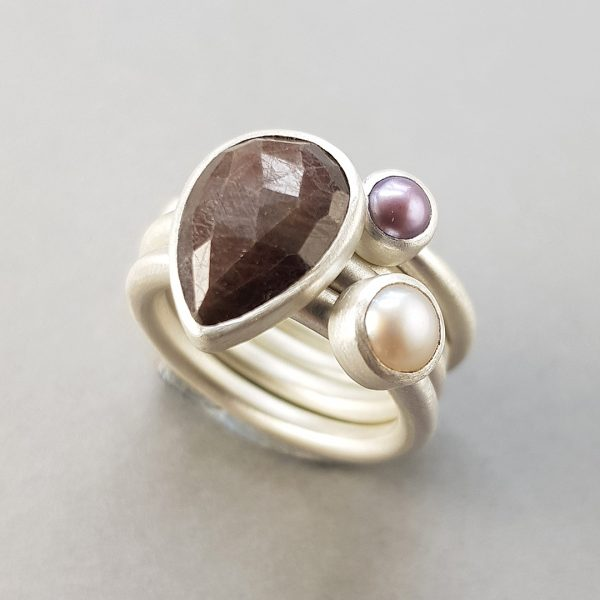 brown sapphire and pearl stacking rings