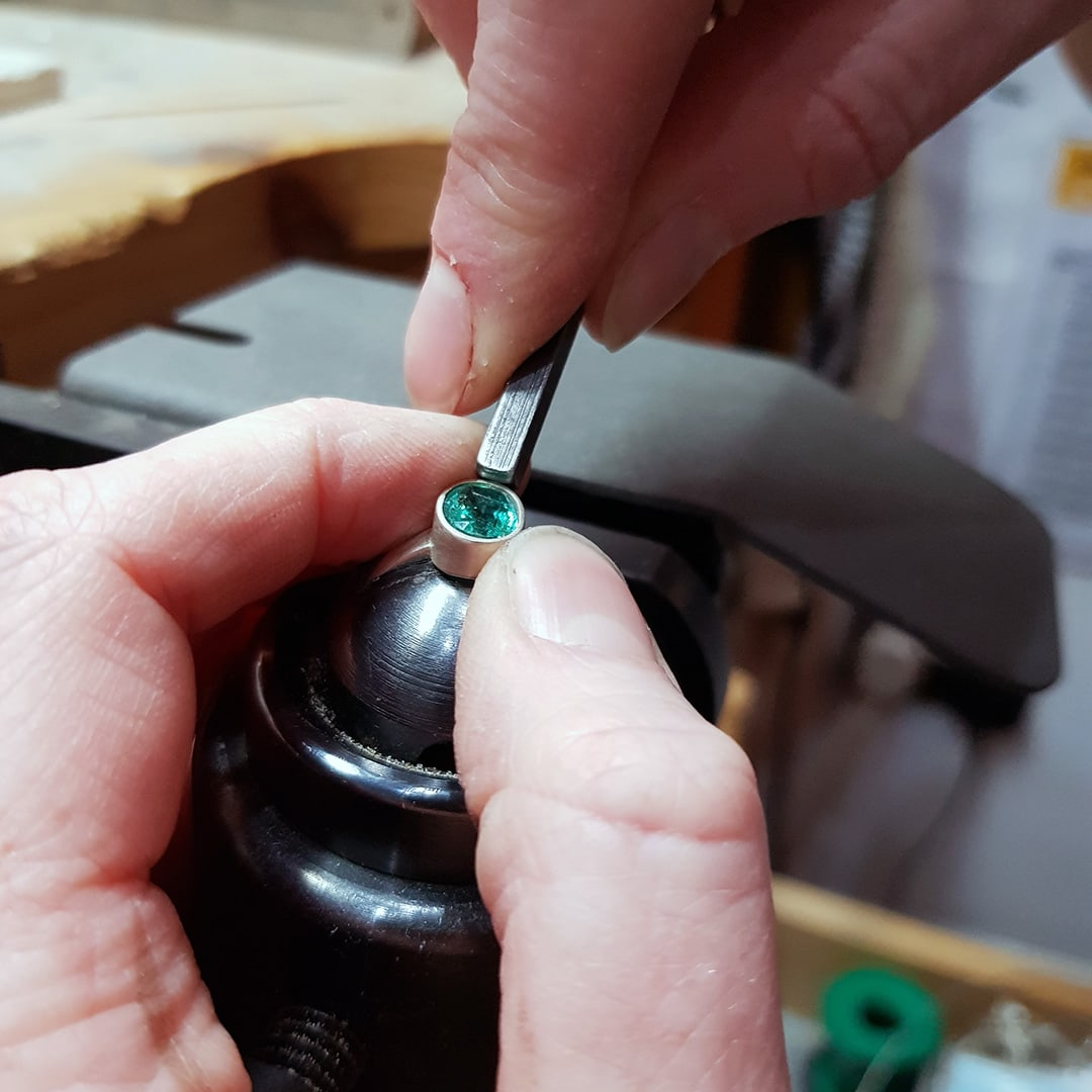 hands at work, setting a stone into a ring