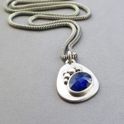 Blue sapphire pendant in brushed silver