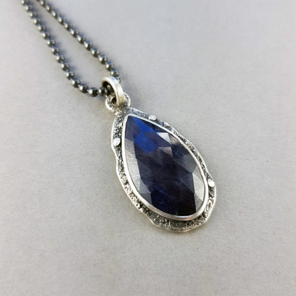 One of a kind blue sapphire and textured silver pendant