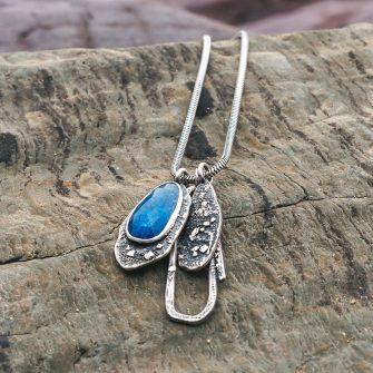 Purple Tanzanite and textured silver pendant