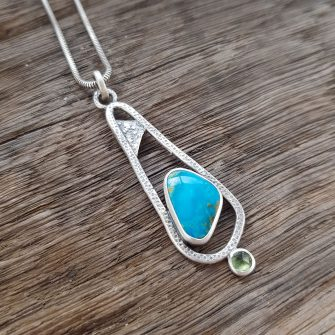 Textured silver pendant with turquoise and peridot