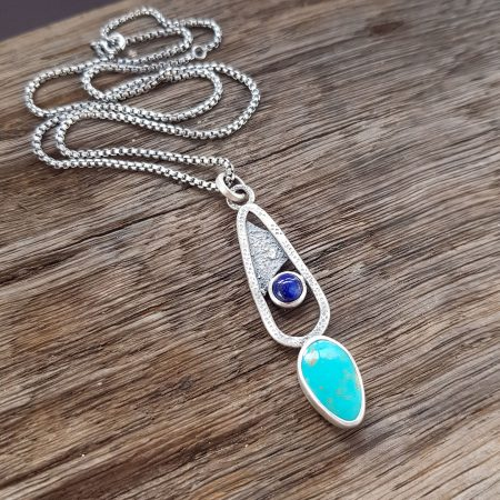 Textured silver pendant with turquoise and lapis lazuli