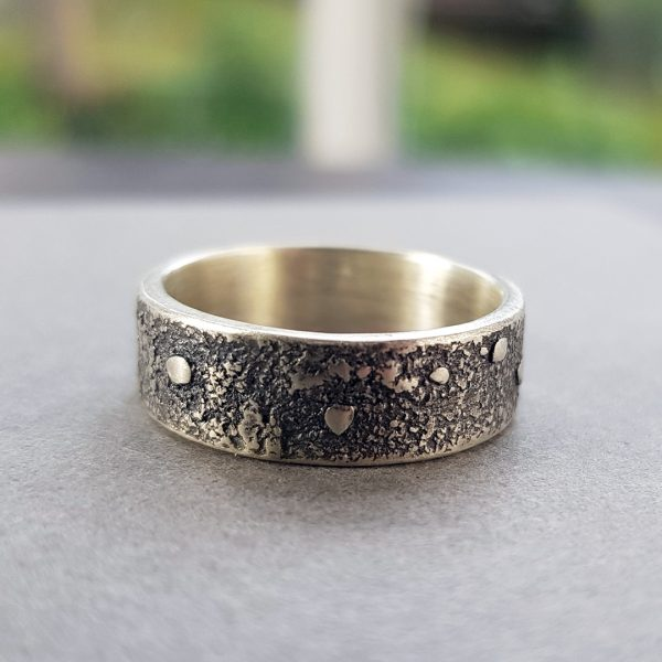 heavily textured silver band ring