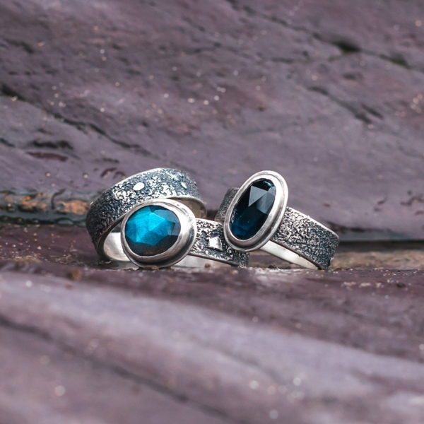 Textured silver band ring with tourmaline rings