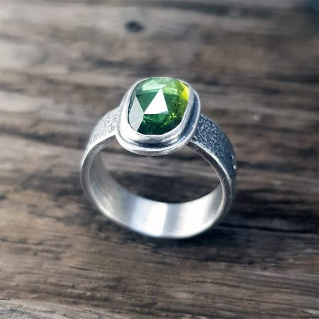 Green rose cut Tourmaline on a textured silver band ring