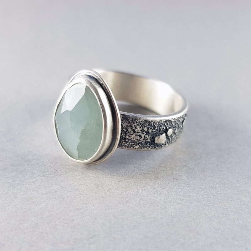 Aquamarine on a textured silver band ring