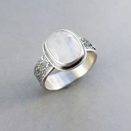 Rainbow Moonstone on a textured silver band ring