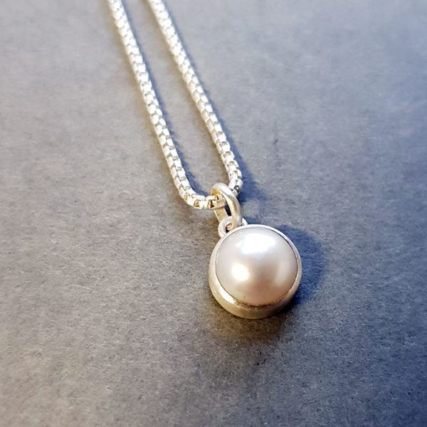 White pearl and brushed silver pendant