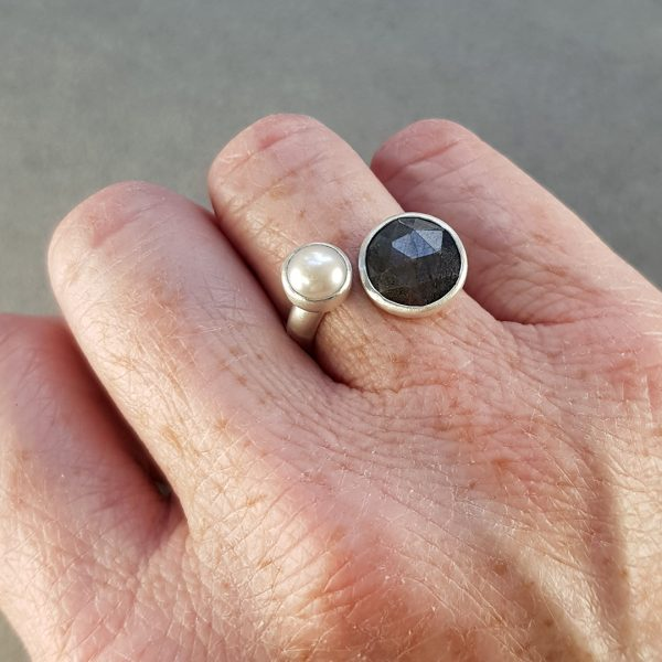 Metallic grey-brown sapphire and white freshwater pearl ring in brushed silver