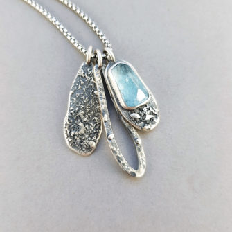 Aquamarine and textured silver pendants