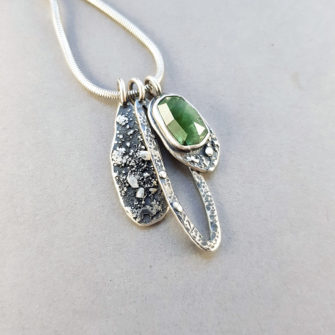 Green Tourmaline and textured silver pendants