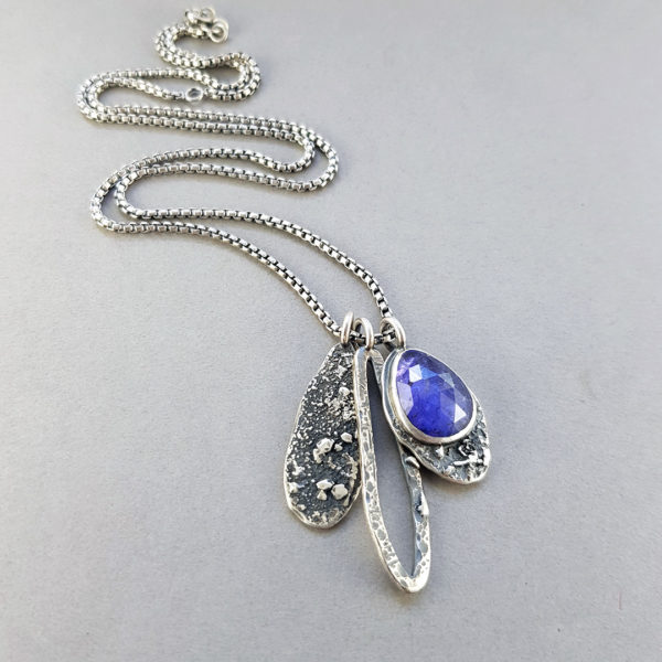 Tanzanite and textured silver pendants