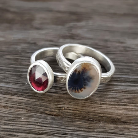 Dendritic agate and red garnet stacking rings in silver on hammered bands