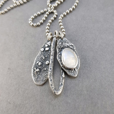 Rainbow moonstone and textured silver pendant with extra silver pendants