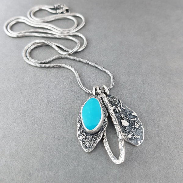 Turquoise and textured silver pendants