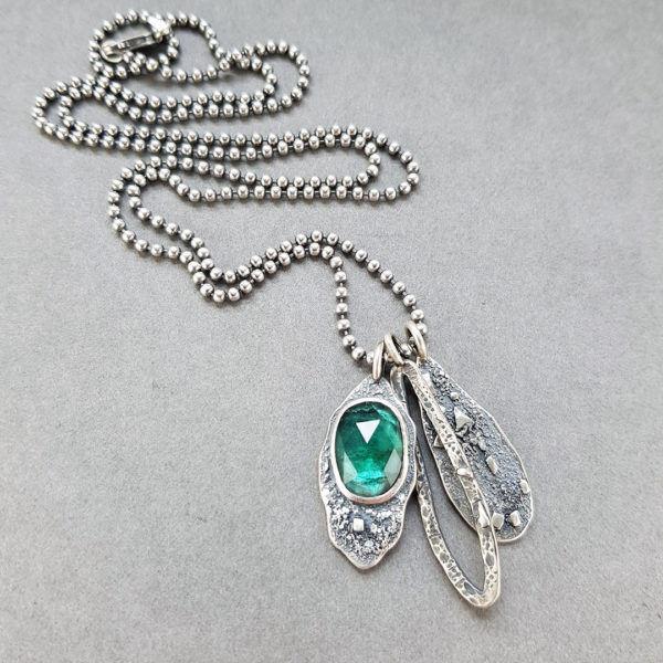 Teal TourmTeal blue Tourmaline and textured silver pendantsaline and textured silver pendants