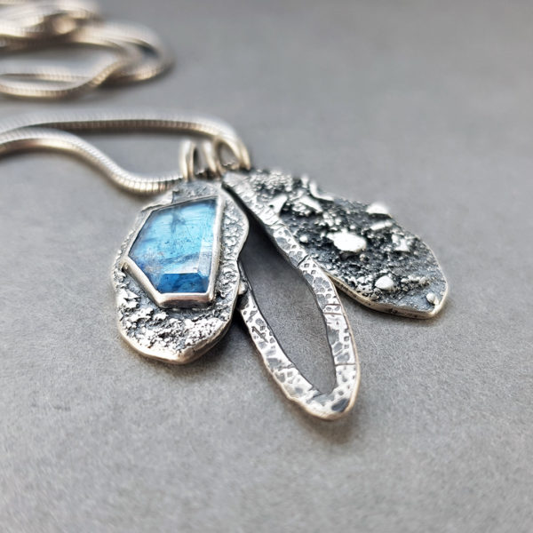 Kyanite and textured silver pendants