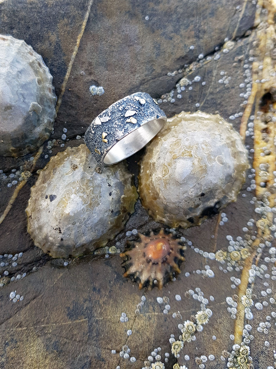 Graham's silver and gold Rugged wedding ring at the beach