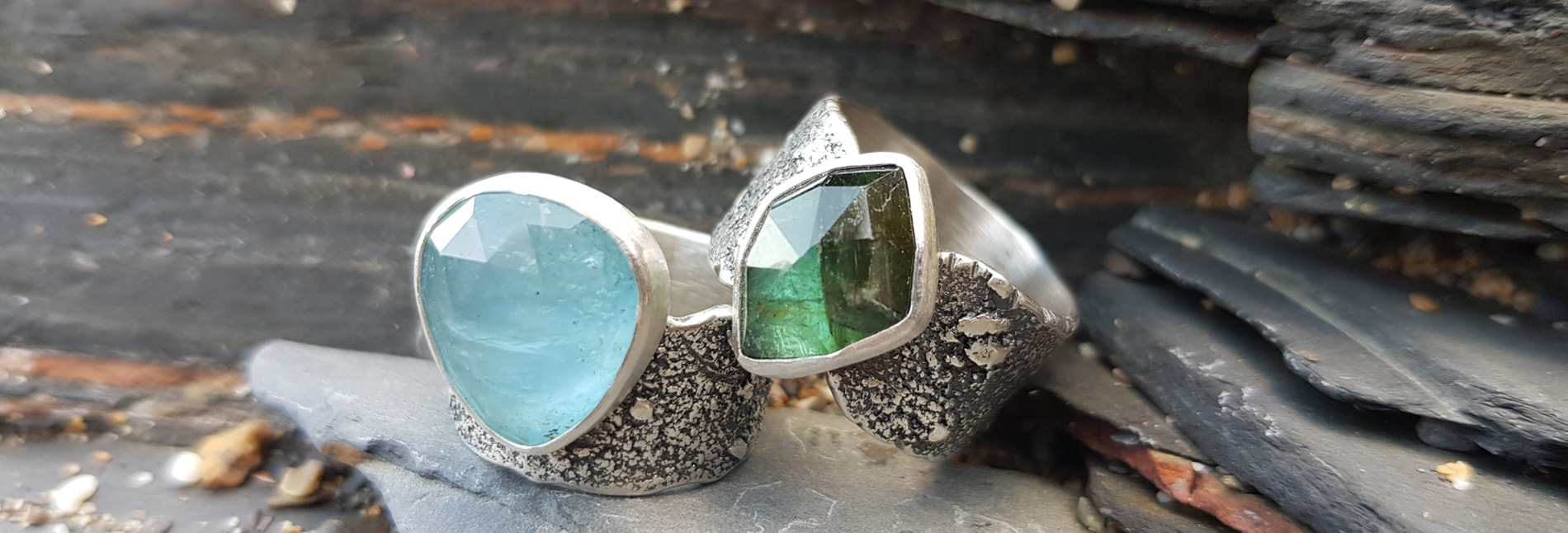 Aquamarine and green Tourmaline rings in textured silver