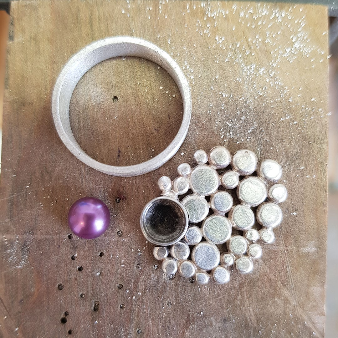 Multi silver pebble ring on the bench