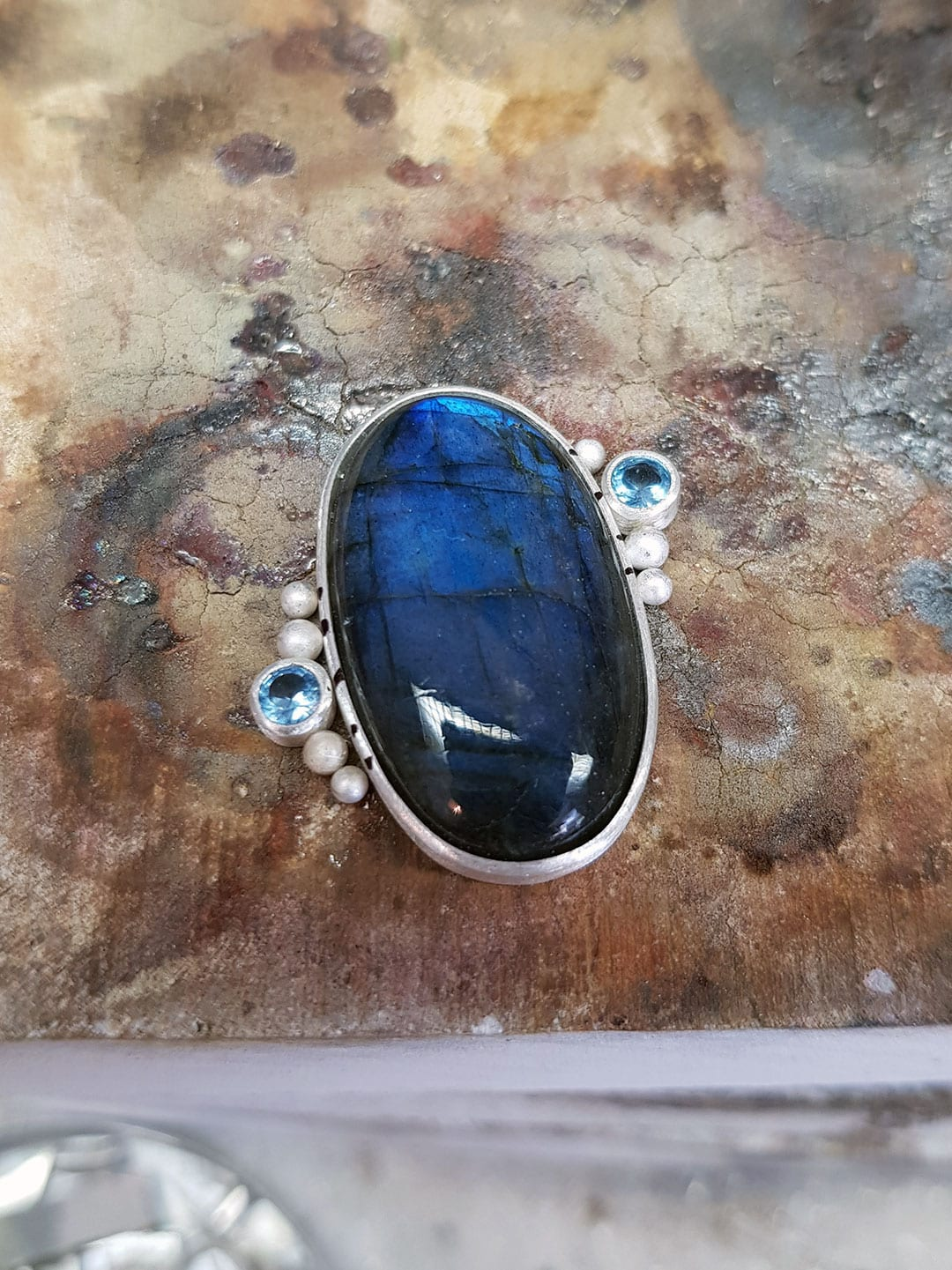 Labradorite and topaz ring commission on the bench