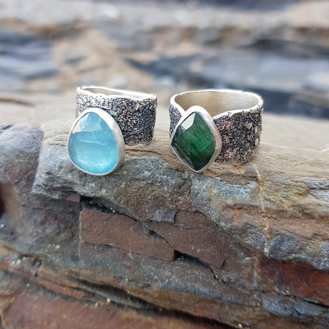 Aquamarine and tourmaline rings in textured sterling silver
