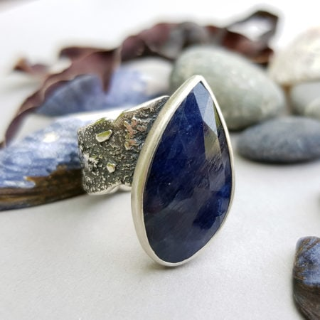 Blue sapphire and textured sterling silver ring