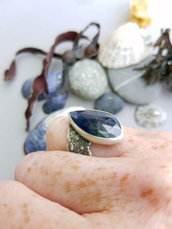 Blue sapphire ring on hand