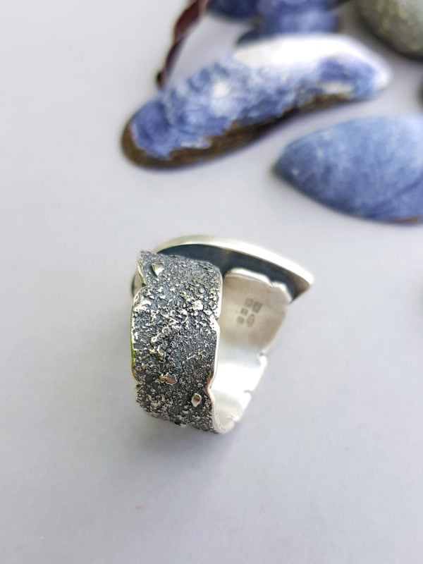 Side view of blue sapphire and sterling silver ring