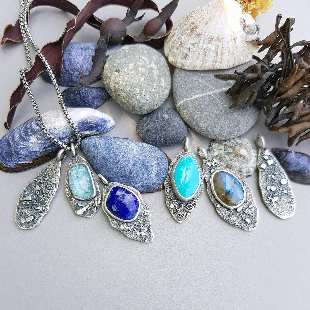 Washed up by the sea, Rugged collection necklaces in fused silver and gems